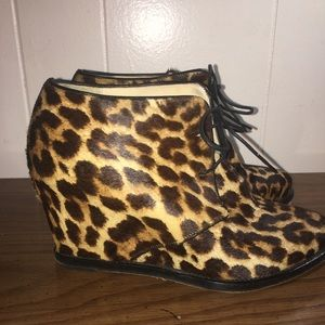 Christian Louboutin Cheetah Print lace up wedges